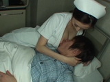 Attentive Nurse Julia Is Calming Down Boy Upset By Tomorrows Surgery