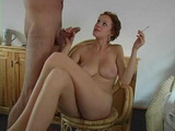Busty Girl Smoking While Giving Her Man A Pleasure