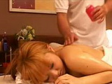Oiled Japan milf has exposed tits sensually massaged